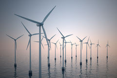 Floating wind turbines during hazy day. Royalty Free Stock Photos