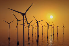 Floating wind turbines at sunset. Royalty Free Stock Photography