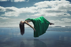 Floating Woman. Over the sea Royalty Free Stock Photo