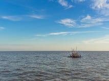 Floating wood buoy on blue sea Stock Photography