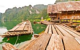 Floating wood house at Ratchaprapha dam Stock Images