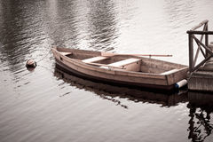 Floating Wooden Boat with Paddles Royalty Free Stock Image