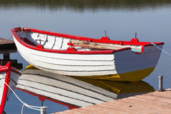 Floating Wooden Boat with Reflection Royalty Free Stock Photo