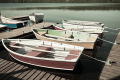 Floating Wooden Boats with Paddles Royalty Free Stock Photography