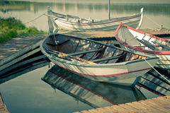 Floating Wooden Boats with Paddles Royalty Free Stock Photo