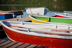 Floating Wooden Boats with Paddles in a Lake Stock Photos
