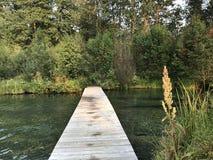 Floating wooden bridge Stock Photography