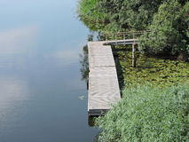 Floating wooden bridge in river Stock Photo