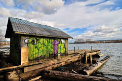 Floating wooden house Stock Photography