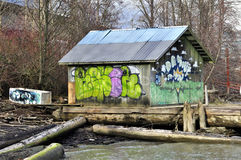 Floating wooden house by a river Royalty Free Stock Photo