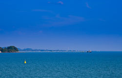 Floating yellow beacon blue sea Royalty Free Stock Images