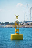 Floating yellow navigation buoy. Stock Images