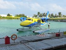 Floatplane arriving at terminal. A Trans Maldivian airways DHC Twin Otter seaplane arriving at Male International Airport in the Maldives Royalty Free Stock Image