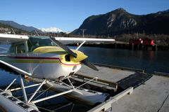 Floatplane Floating. A floatplane moored to a dock in a small coastal town Royalty Free Stock Photography