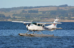 Floatplane on Lake Rotorua New Zealand. ROTORUA, NZL - JAN 12 2015:Floatplane mooring on Lake Rotorua, New Zealand.Seaplanes can only take off and land on water Stock Image