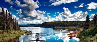 Floatplane landing on lake