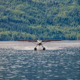 Floatplane landing on water. In Alaska Royalty Free Stock Image