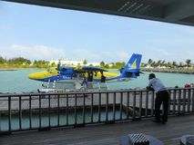 Floatplane moored at terminal. A Trans Maldivian airways DHC Twin Otter seaplane moored up at Male International Airport in the Maldives Stock Images