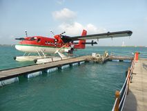 Floatplane at mooring. A Maldivian Air Taxi DHC Twin Otter seaplane at its mooring at Male International Airport in the Maldives Stock Photography