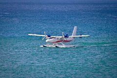 Floatplane mooring on open sea. Floatplane mooring on open turquoise sea Stock Photos