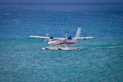 Floatplane mooring on open sea Stock Photos