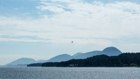Floatplane over Ketchikan. A floatplane flies over the waters surrounding Ketchikan, Alaska Stock Photography