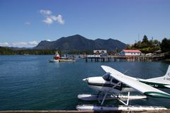 Floatplane parked in harbour in Tofino, British Columbia, Canada. On a sunny spring day, a floatplane is parked in the harbour in Tofino on Canada's Vancouver Royalty Free Stock Photos