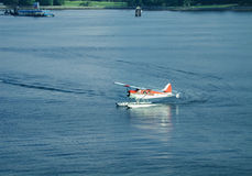 Floatplane Taxiing in Vancouver Harbor Royalty Free Stock Photography