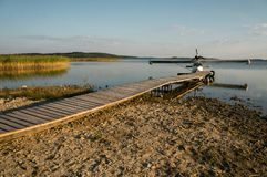 Floatplane at wooden pier. On beautiful lake Royalty Free Stock Photos