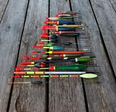 Floats. Fishing floats in different shapes on wooden background Stock Images