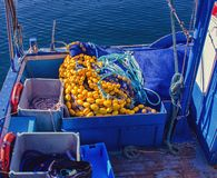 Floats and fishing net on the deck of a fishing vessel.  royalty free stock image