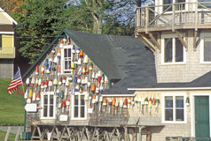 Floats from fishing nets hang on the side of a lighthouse in Stonington, Mount Desert Island, Maine royalty free stock photo