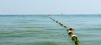 Floats on the ocean marking a channel or entrance Stock Photo
