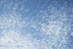 Floccus and cumulus clouds. And blue sky in a sunny day Royalty Free Stock Photo