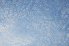 Floccus and cumulus clouds. And blue sky in a sunny day Royalty Free Stock Images