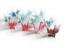 A flock of birds. A group of origami cranes on a white background Royalty Free Stock Photo