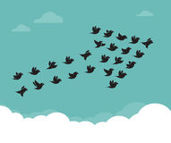Flock of birds flying in the sky in an arrow Royalty Free Stock Photo
