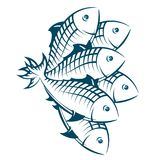 A flock of fish. Silhouetted, seafood symbol Stock Images