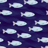 Flock of fishes seamless pattern. Blue dark blue waves eps10 Royalty Free Stock Photos