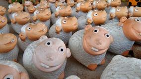 Flock of happy smiling sheep Stock Photos