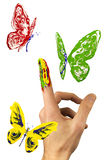 Flock of painted butterflies flying around finger Stock Image