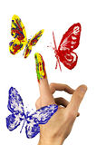 The flock of painted butterflies flying around finger Royalty Free Stock Photo