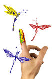Flock of painted dragonflies flying around finger Stock Photography