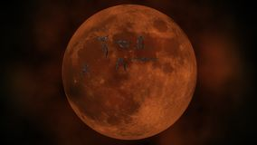 A flock of vampire bats flies against a blood red moon. Halloween concept.