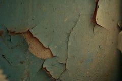 Flockige blaue Farbe auf der Wand Stockbild