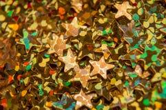 Flockige kleine goldene Sterne Stockbild
