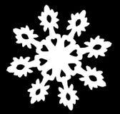 Floco de neve branco em um fundo preto foto de stock