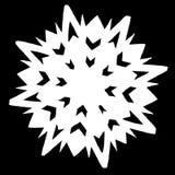 Floco de neve branco em um fundo preto imagens de stock