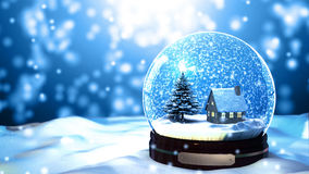 Floco de neve do globo da neve do Natal com queda de neve no fundo azul imagens de stock