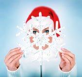 Floco de neve nas mãos da menina de Santa Fotos de Stock Royalty Free